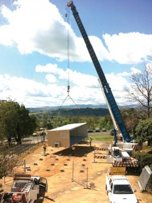 Part of Tumut's new self-care renal dialysis facility is craned into place.