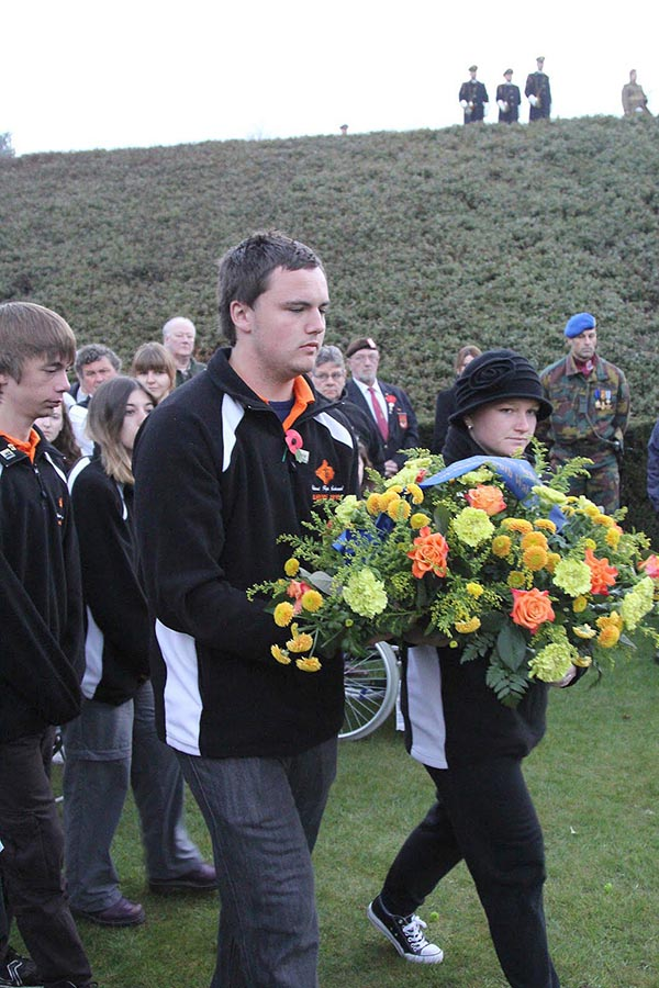 Tumut High representatives Josh Casey and Brooke Jeffery laying a wreath at the Anzac Day service at Polygon Wood on behalf of Darren Mitchell, head of Veterans Affairs.