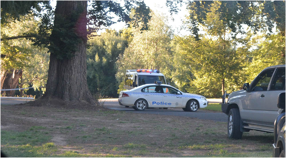 Police and ambulance at the scene of a fatal motorcycle crash on Elm Drive, near the Tumut Racecourse, yesterday.