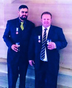 Adam Smith and Scott Skein sharing a beer and proudly wearing their bronze medals following a ceremony at NSW Government House.