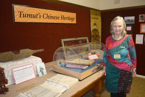 Tumut Historical Society committee member Jackie Green with part of the Chinese exhibition at the Tumut Museum in Capper Street.