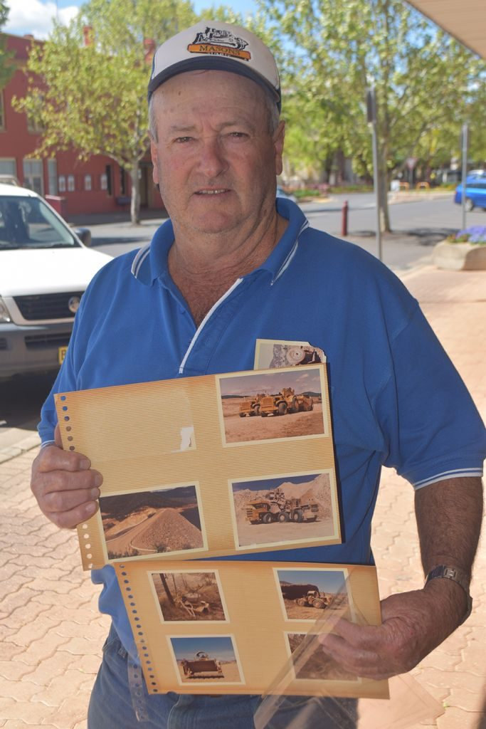 Tumut's Vern Walsh with photos from his time with the Snowy Mountains Scheme, which has just been placed on the National Heritage List.