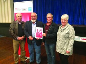 Phil Bennetts, Tim Oliver, and Mal and Judy Gray with the certificate recognising the Friends of Snowy Hydro SouthCare Tumut Chapter.